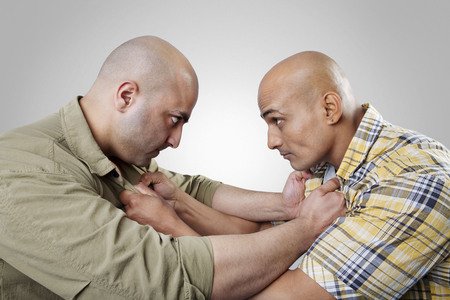 rival: Bald men fighting Stock Photo