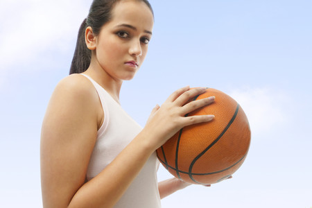 Portrait of a girl holding a basketball