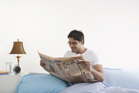 one sheet: Man reading a newspaper