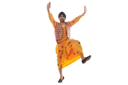 religious clothing: Portrait of a Sikh man doing bhangra dance Stock Photo