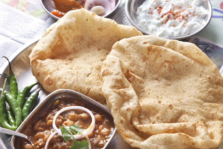 Close-up chole bhature served at table