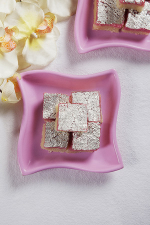 Top view of coconut barfi in a plate