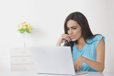 front house: Young woman using laptop at home