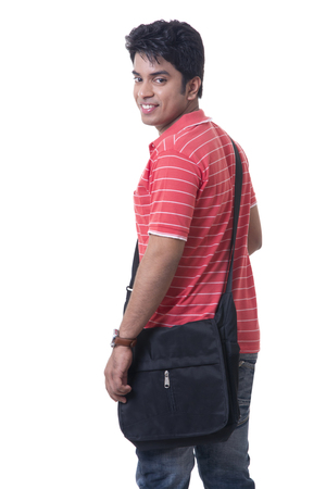 Portrait of happy male student with bag against white background