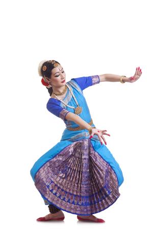 Full length of beautiful woman performing Bharatanatyam on white background