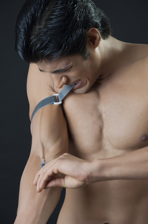 sharp: Young man giving himself an injection