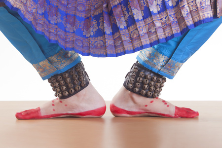 Low section of dancers feet performing Bharatanatyam over white background Stock Photo