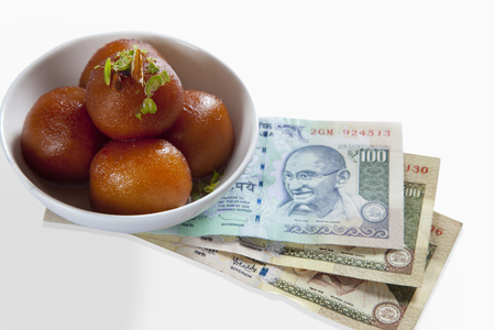 Gulab jamun with currency