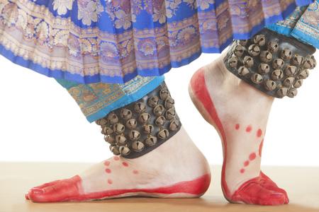 Bharatanatyam dancers feet performing over white background Stock Photo