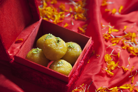 Close-up of laddus in a box