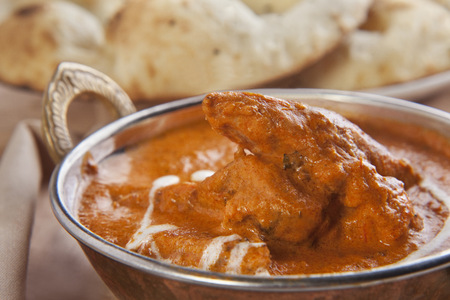 Close-up of butter chicken served in container