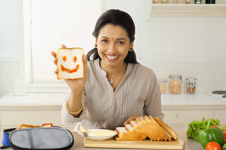 smiley: Mother preparing lunch box Stock Photo