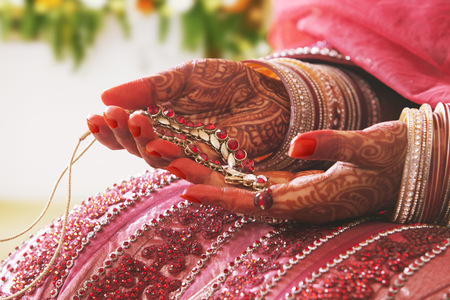bride bangle: Close-up of a Brides hands holding necklace Stock Photo