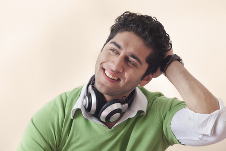 music background: Portrait of young man wearing headphones Stock Photo