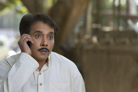front view: Man talking on cell phone