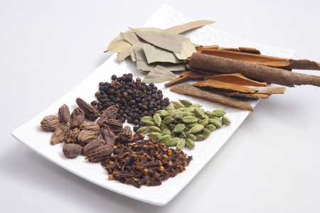 Various spices arranged on a plate