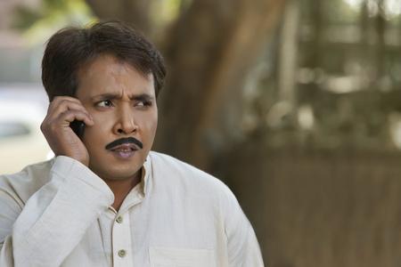 kurta: Man talking on cell phone