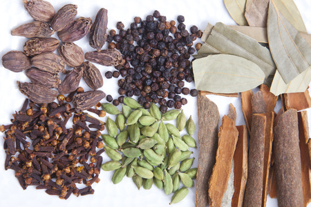 Various spices arranged on a white background Stock Photo