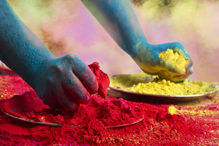 Close-up of hands holding powder paints during Holi festival Stock Photo