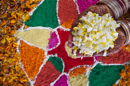 religious clothing: Close-up of a Brides hand holding flower petals Stock Photo