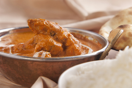 Butter chicken served in container