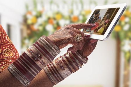 bride bangle: Close-up of a Brides hand using tablet computer