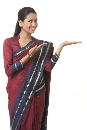 gesturing: Woman smiling and gesturing