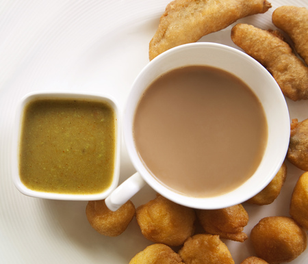 appetiser: Close-up of tea with bhajiyas and sauce Stock Photo