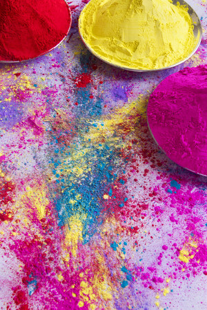 Containers of powder paint during Holi festival Stock Photo