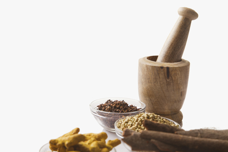 eating utensil: Bowls of spices with wooden mortar and pestle Stock Photo
