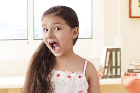 preadolescent: Portrait of smiling girl pulling funny faces