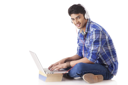 music background: Young man Working on laptop