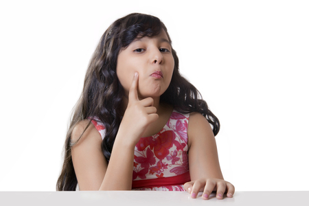 preadolescent: Portrait of a girl with her hand on her cheek