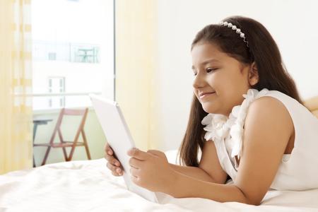 preadolescent: Girl using digital tablet