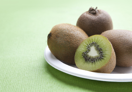 cross: Close-up view of Kiwi fruit on plate Stock Photo