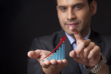 increasing: business man hold a chart with increasing beam Stock Photo