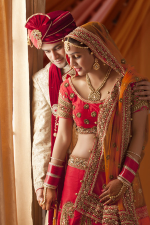 ear ring: Handsome groom and beautiful bride, young couple