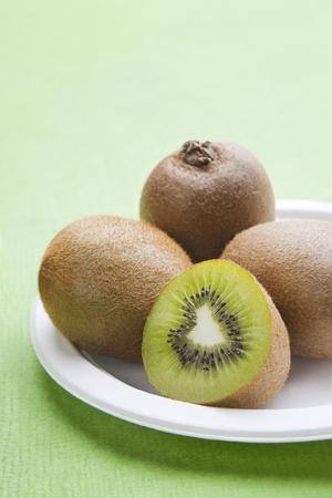 actinidia deliciosa: Close-up view of Kiwi fruit on plate Stock Photo