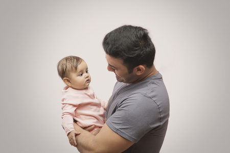 Smiling Father Playing baby girl