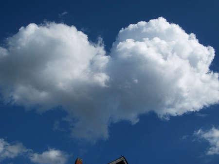 Cumulus clouds. Heart photo