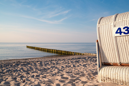 Panoramic view of the Baltic Sea with beach chairs and dunes