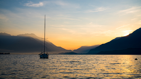 Sunrise on Lake Como with boat on the water Stock Photo
