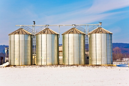 acre: beautiful landscape with silo and snow white acre with blue sky