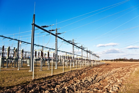 isolator insulator: electricity relay station with high-voltage insulator and power lines Stock Photo