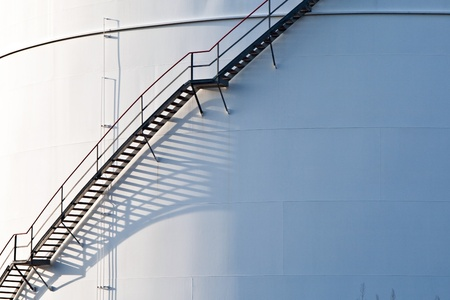 industrial stair at white tank   photo