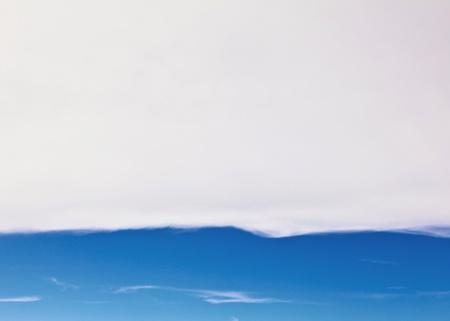 troposphere: puffy white cloud blue sky