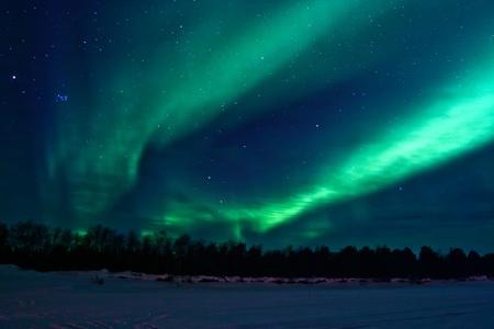 aurora polaris: Northern lights (aurora borealis) display near Kaamanen, Finland