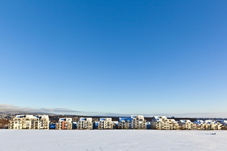 beautiful landscape with housing area in winter and blue sky photo