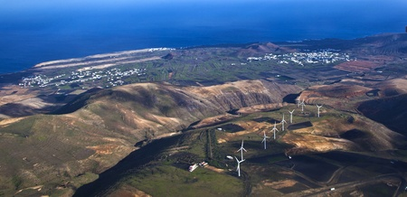 aerial of Lanzarote with wind power plants on volcano photo