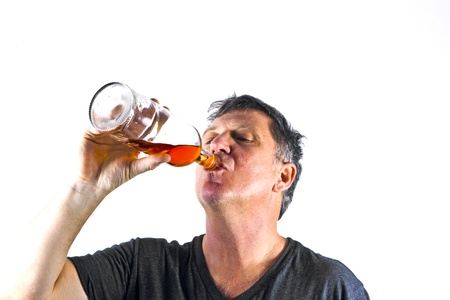 without people: man drinking alcohol out of a bottle Stock Photo